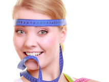 Obsessed girl with measure tapes around her head Stock Images