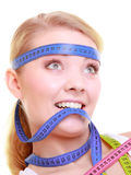 Obsessed girl with violet measure tapes around her head Royalty Free Stock Images
