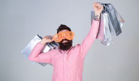 Obsessed with shopping. Addicted consumer concept. Man bearded hold shopping bags. Shopping dumb wasting money. Stupid. Things you do with your money. How to royalty free stock image