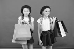 Obsessed with shopping and clothing malls. Shopaholic concept. Signs you are addicted to shopping. Kids cute schoolgirls stock photography