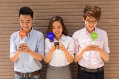 Obsessed with smartphones Stock Photos