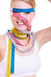 Obsessed sporty fit woman with measure tapes. Time for diet slimming. Royalty Free Stock Photography