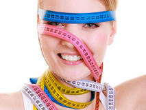 Obsessed sporty fit woman with measure tapes. Time for diet slimming. Royalty Free Stock Photo