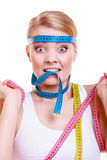Obsessed sporty fit woman with measure tapes. Time for diet slimming. Stock Photo