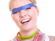 Obsessed woman with colorful measure tapes Stock Images