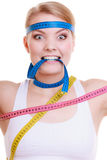 Obsessed woman with measure tapes. Diet. Royalty Free Stock Photo