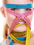Obsessed woman with measure tapes. Diet. Stock Photography