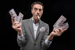 Rich adult businessman is demonstrating dollars Stock Photos