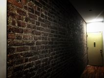 Obsession. Brick wall artsy indoors iPhone photography royalty free stock image