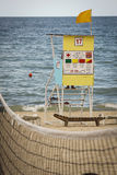 Obsession for the lifeguard in the sea Stock Images