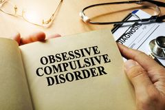 Obsessive compulsive disorder concept. Book on a table Stock Images