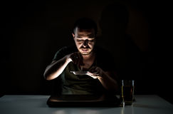 Obsessive smoker in the dark Stock Image