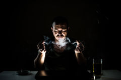 Obsessive smoker in the dark Stock Photo
