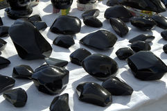 Obsidian 1. Polished gemstones on display at a gem and mineral show Royalty Free Stock Photos