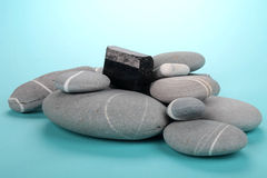Obsidian over rocks Royalty Free Stock Photography