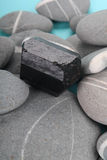 Obsidian over rocks Stock Image