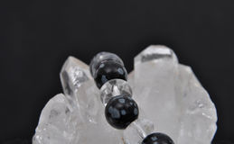 Obsidian on rock crystal Stock Photos