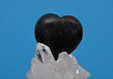 Obsidian on rock crystal Royalty Free Stock Photos