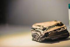 Obsidianstenprov för utbildning Obsidian är naturligt en nolla Royaltyfri Foto