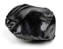 Obsidien noir sur le fond blanc image libre de droits