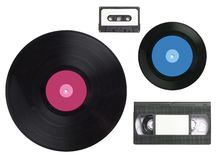 Obsolete audio-visual. Selection of obsolete audio visual items, video tape,vinyl records and cassette tape, isolated on white stock images