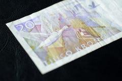 Obsolete Banknote in twenty Swedish kronor. On a dark background Stock Photos