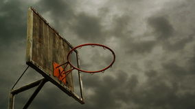Obsolete Basketball hoop with cage with clouds time lapse footage in background. Royalty Free Stock Image