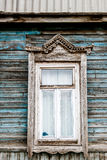 Obsolete blue wall and old wooden window. Russian traditional style Royalty Free Stock Images
