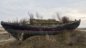 Obsolete Boat on the Shore Stock Photos