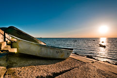 Obsolete boats on embankment Royalty Free Stock Photo