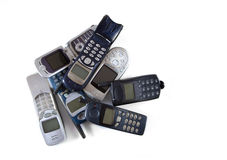 Obsolete cellular phones. Isolated on a white background Royalty Free Stock Images