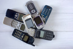 Obsolete cellular phones. Old device recycle Stock Image