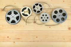 Obsolete cinema films on wooden surface of table. Copy space Stock Photo