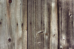 Obsolete fence with vertical boards and nails. Rustic planked fence from vertical wooden boards with nails royalty free stock photos