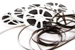 Obsolete Film Media. Obsolete rolls of old 8mm movie film are wound on white plastic reels Royalty Free Stock Image