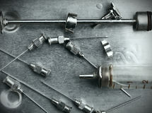 Obsolete glass syringe and needles. In the steel tray Royalty Free Stock Images