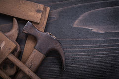 Obsolete hand saw surface gauge claw hammer square. Ruler Royalty Free Stock Photos
