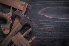 Obsolete hand saw wooden marking gauge claw hammer. Square ruler Royalty Free Stock Photography