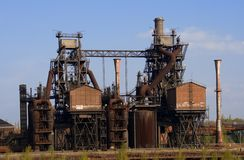 Obsolete Industrial Plant. An obsolete industrial plant, with several chimneys and a lot of rust Stock Photography