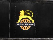 Historic lion and wheel emblem. The obsolete lion and wheel emblem of the British Railways network on the side of an old steam locomotive in England Stock Images