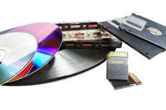 Obsolete and modern storage devices Stock Images