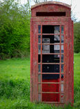 Obsolete and neglected Telephone Box. Stock Photo