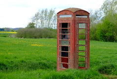 Obsolete and neglected Telephone Box. Royalty Free Stock Image