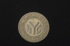 An obsolete New York City subway token Stock Images