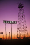 Obsolete oil rigs at sunset. Russell, KS stock photos