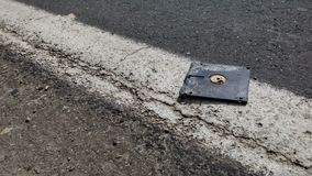 Obsolete Old Tech Floppy Disk Laying on the road royalty free stock photography