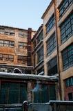 Obsolete plant with big windows. Obsolete, damaged, yellow plant with big windows Stock Photography