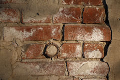 Obsolete plastered brick wall. Obsolete red plastered brick wall with rusty pipe Royalty Free Stock Image