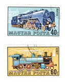 Obsolete post stamps with trains stock photos