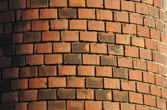 The obsolete red-orange rounded brewing chimney built from brick Royalty Free Stock Photography